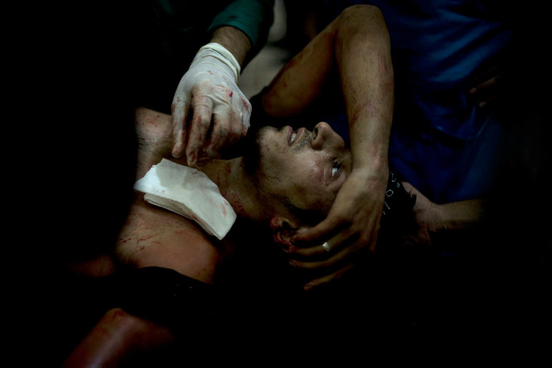 . A rebel fighter is brought to the Dar al-Shifa hospital in the northern city of Aleppo to be treated for his wounds on October 1, 2012, as fighting in Syria\'s second largest city between rebel forces and government troops continues. AFP PHOTO/ZAC  BAILLIE/AFP/Getty Images