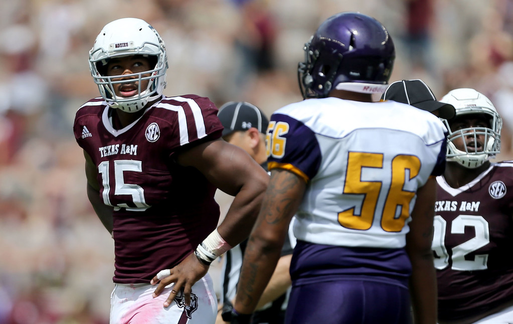 . Texas A&M defensive lineman Myles Garrett (15) looks towards the score board for a replay against Prairie View A&M during the second half of an NCAA college football game Saturday, Sept. 10, 2016, in College Station, Texas. (AP Photo/Sam Craft)