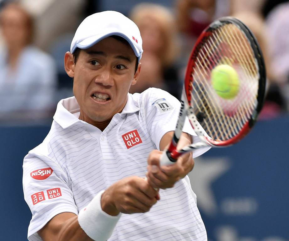 . Kei Nishikori of Japan hits a return to Marin Cilic of Croatia during their US Open 2014 men\'s singles finals match at the USTA Billie Jean King National Center September 8, 2014  in New York. STAN HONDA/AFP/Getty Images
