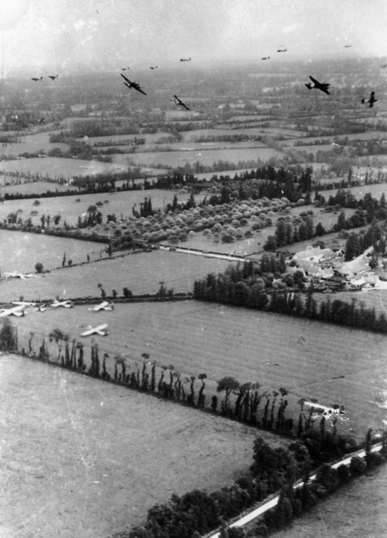 . 6th June 1944:  Taken on D-Day, the fields of Northern France are covered with Waco gliders of the Ninth Air force Troop Carrier Command, whilst other gliders prepare to land, whilst Douglas C 47 glider tugs leave the area.  (Photo by Keystone/Getty Images)