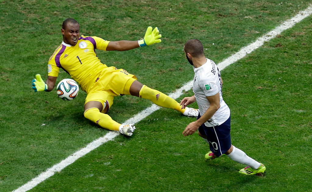 . Nigeria\'s goalkeeper Vincent Enyeama, left, deflects a ball by France\'s Karim Benzema during the World Cup round of 16 soccer match between France and Nigeria at the Estadio Nacional in Brasilia, Brazil, Monday, June 30, 2014. (AP Photo/Hassan Ammar)