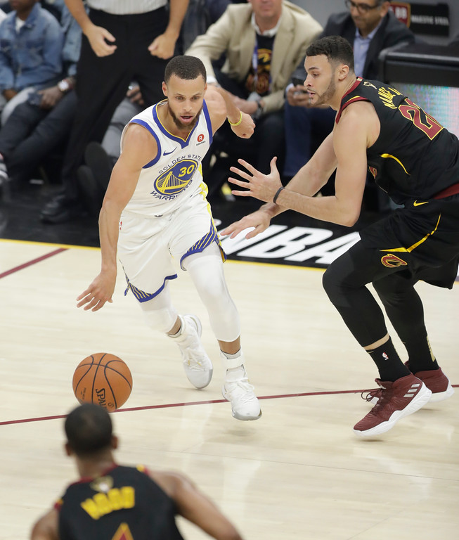 . Golden State Warriors\' Stephen Curry is defended by Cleveland Cavaliers\' Larry Nance Jr. in the first half of Game 4 of basketball\'s NBA Finals, Friday, June 8, 2018, in Cleveland. (AP Photo/Tony Dejak)