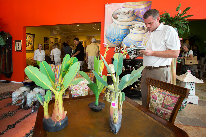 Photo: Jacek Gancarz. Caption: Friday, February 21, 2014 - Paul Ryan of New York, NY, examines merchandise in the showroom of Leslie Hindman Auctioneers in West Palm Beach, Fla. during a preview of property from the estate of Lilly Pulitzer of Palm Beach, Fla. The auction takes place on Saturday, February 22, 2014.