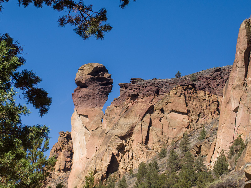 Monkey Face Rock.  Rock Climbers are inside the mouth and rappelling down the chin