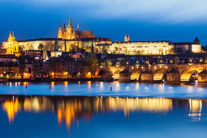 View of Charles Bridge (Karluv most) and Prague Castle (Pražský hrad) in twilight