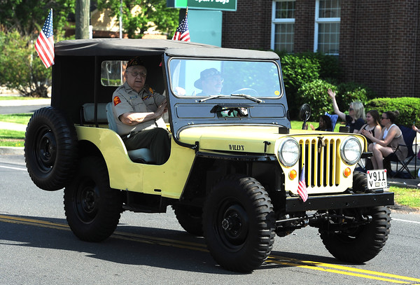 5/26/2018 Mike Orazzi   Staff Al Gregory rides with Eric Weiss in Weiss' 1952 Jeep Willys during the Berlin Memorial Day Parade on Saturday along Farmington Avenue.