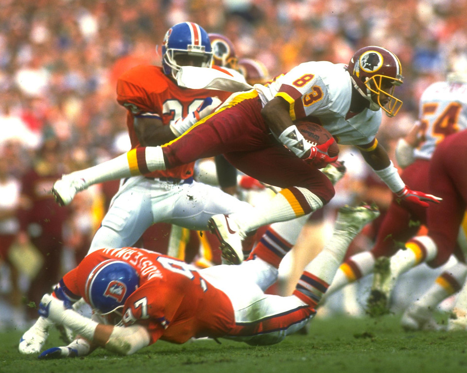 . Washington Redskins wide receiver Ricky Sanders #83 is tripped up by the Denver Broncos defense during Super Bowl XXII in San Diego, California.  Rick Stewart/Allsport
