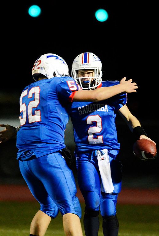 . Erica Miller - The Saratogian @togianphotog      Saratoga\'s Jake Eglintine celebrates with Austin Degener after scoring a touchdown during the third quarter during their playoff football game against LaSalle on Friday evening under the lights in Saratoga. SAR-l-SarFootball11