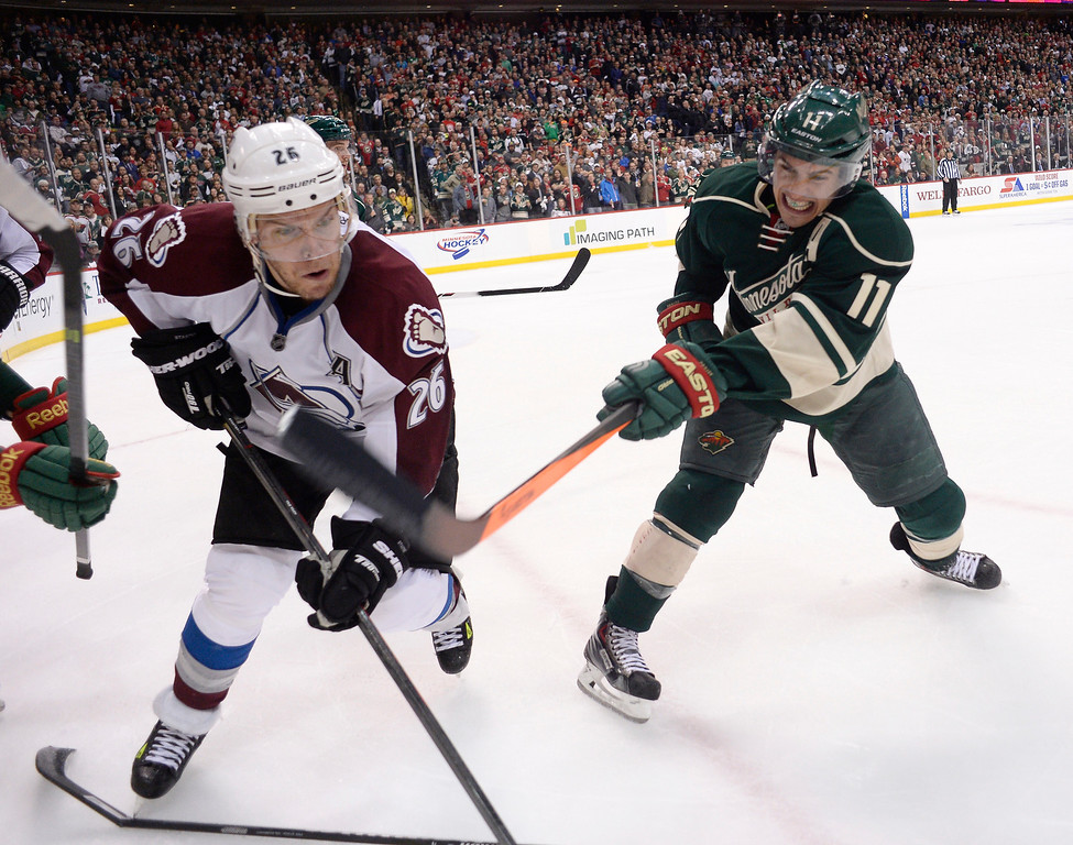 . Minnesota Wild left wing Zach Parise (11) slashes at Colorado Avalanche center Paul Stastny (26) stick as he goes for the puck with second in the third period April 24, 2014 in Game 4 of the Stanley Cup Playoffs at Xcel Energy Center. The Wild defeated the Avalanche 2-1.  (Photo by John Leyba/The Denver Post)