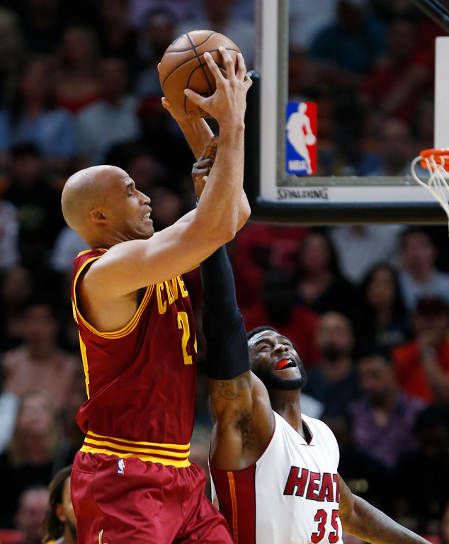 . Cleveland Cavaliers forward Richard Jefferson, left, prevents a shot by Miami Heat center Willie Reed (35) during the first half of an NBA basketball game, Monday, April 10, 2017, in Miami. (AP Photo/Wilfredo Lee)
