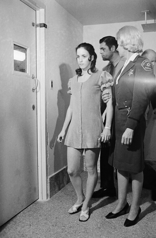 . Susan Denise Atkins, 21, leaves a Los Angeles courtroom after pleading innocent to charges she murdered actress Sharon Tate and six others, Dec. 16, 1969. The young woman from San Jose, Calif., wore the same pink velvet dress she wore in previous court appearances.  (AP Photo)