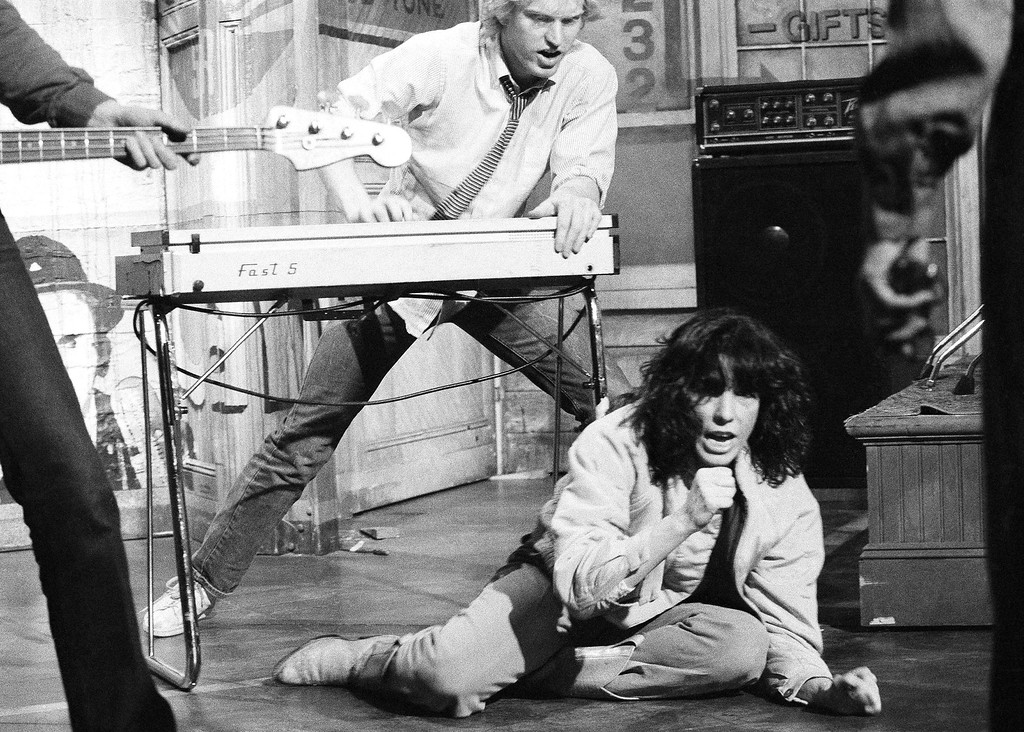 . Comedienne Lily Tomlin rehearses her punk rock act as �Agnes Angst� in New York on Jan. 21, 1983 for �Saturday Night Live� show on NBC-TV. Brad Hall, a regular on the show, plays the synthesizer. (AP Photo/Marty Lederhandler)