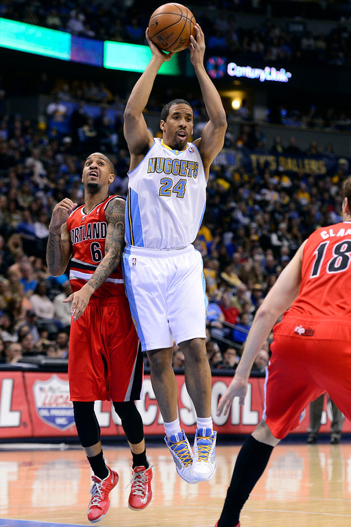 . DENVER, CO - APRIL 14: Andre Miller (24) of the Denver Nuggets looks for a teammate as Eric Maynor (6) of the Portland Trail Blazers defends during the first half of action. The Denver Nuggets play the Portland Trail Blazers at the Pepsi Center. (Photo by AAron Ontiveroz/The Denver Post)