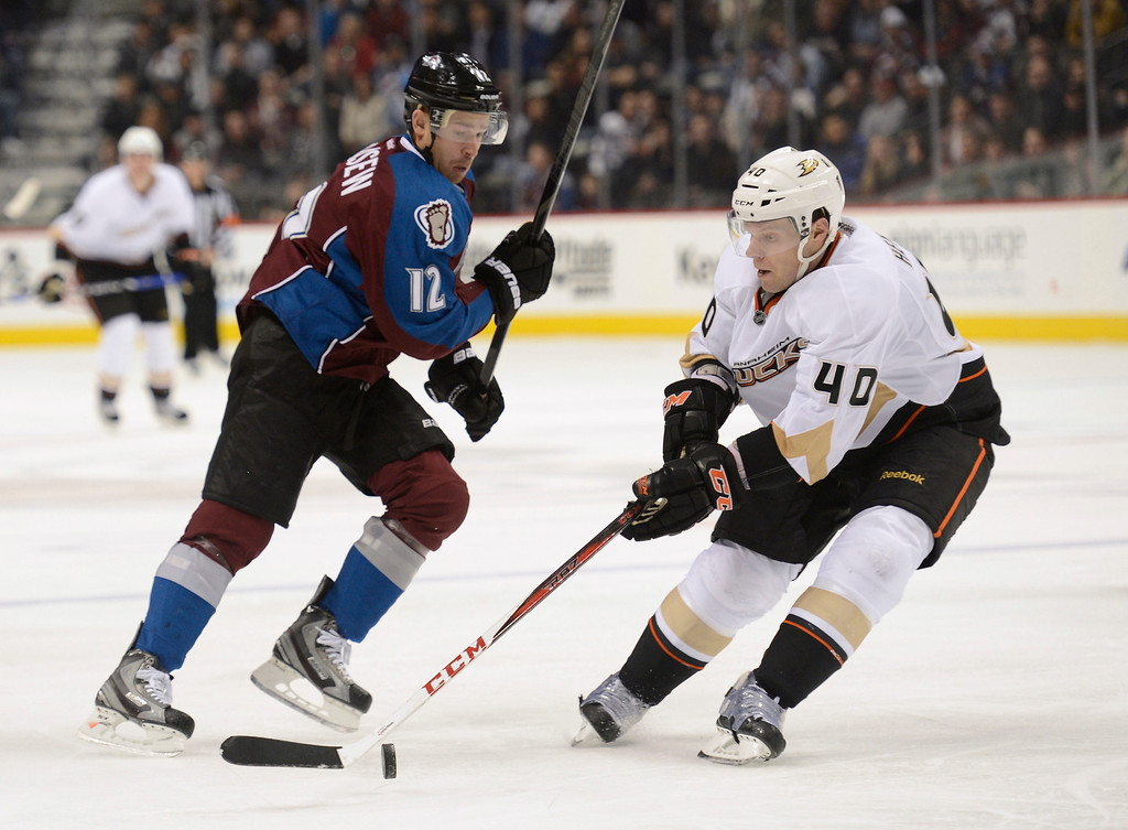 . DENVER, CO. - FEBRUARY 06: Jordan Hendry (40) of the Anaheim Ducks gains control of the puck in front of Chuck Kobasew (12) of the Colorado Avalanche during the third period February 6, 2013 at Pepsi Center. The Colorado Avalanche fall to the Anaheim Ducks  3-0 during NHL action. (Photo By John Leyba / The Denver Post)