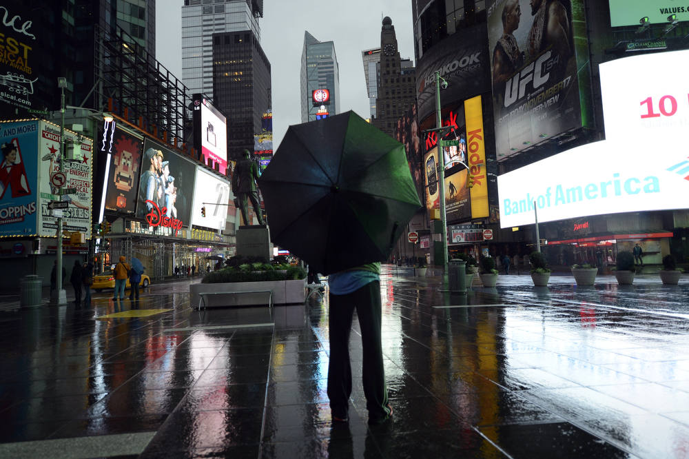 Description of . A lone tourist stands  in Times Square  early October 29, 2012 as New Yorkers prepare for Hurricane Sandy which is supposed to hit the city later tonight Much of the eastern United States was in lockdown mode October 29, 2012 awaiting the arrival of a hurricane dubbed