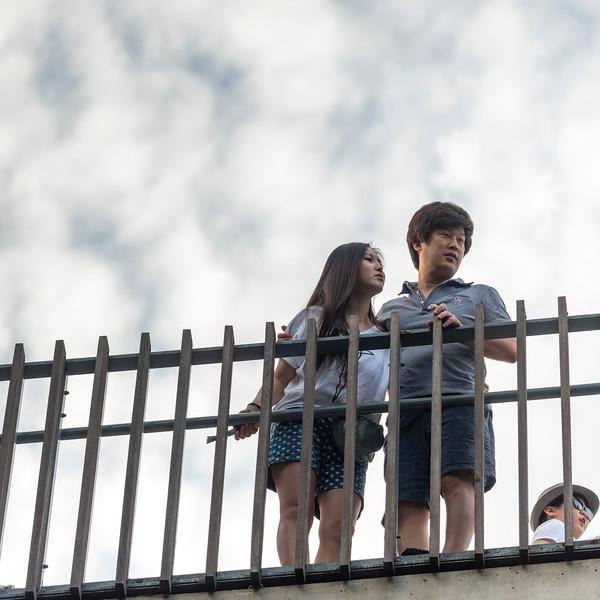 Low angle view of couple standing near railing, Seoul, South Korea