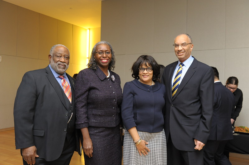 Judge Janet Malone, Candidate for New York State Supreme Court Justice alongside her husband. (left of photo)  Seymour W. James Jr. alongside his wife. (right of the photo)