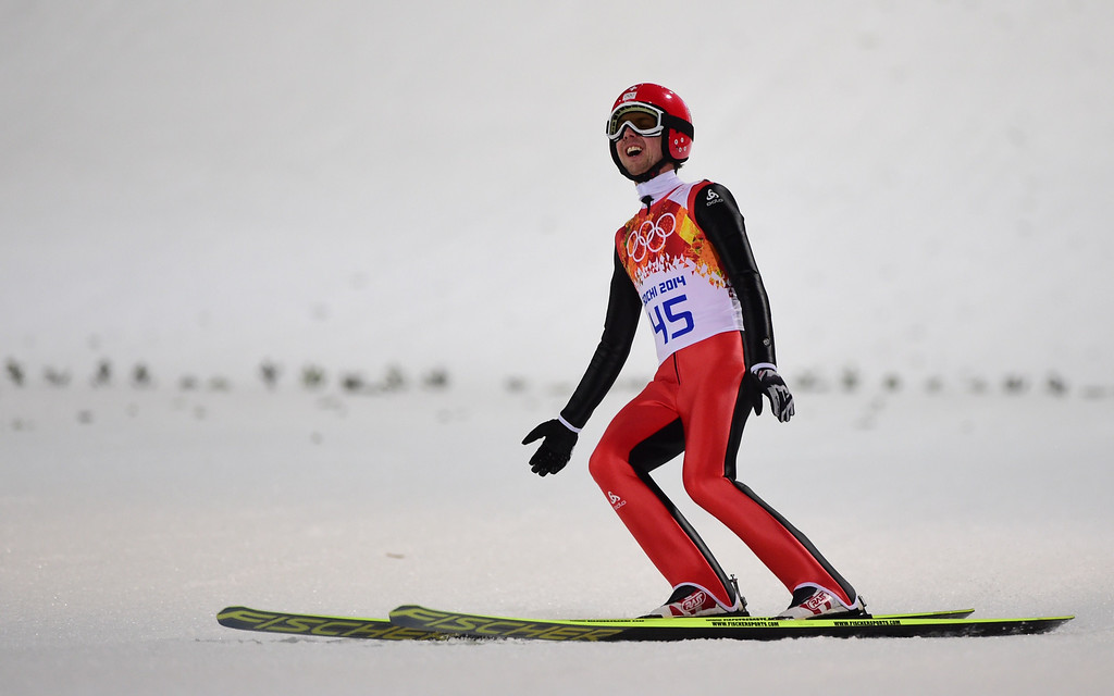 . Switzerland\'s Simon Ammann competes in the Men\'s Ski Jumping Normal Hill Individual Final Round at the RusSki Gorki Jumping Center during the Sochi Winter Olympics on February 9, 2014 in Rosa Khutor. JOHN MACDOUGALL/AFP/Getty Images
