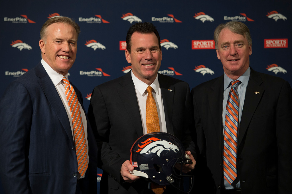 . Denver Broncos John Elway, General Manager and Executive Vice President of Football Operations Head Coach Gary Kubiak and Joe Ellis President and CEO pose for photos after press conference January 20, 2015 at Dove Valley. Kubiak becomes the 15th head coach in franchise history. (Photo By John Leyba/The Denver Post)