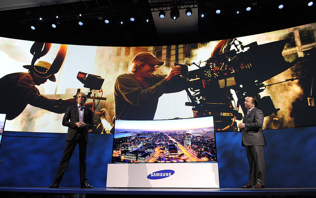 . Samsung Electronics America Executive Vice President Joe Stinziano (R) and movie director Michael Bay (L) speak at the Samsung press event at the Mandalay Bay Convention Center for the 2014 International CES on January 6, 2014 in Las Vegas, Nevada. (ROBYN BECK/AFP/Getty Images)