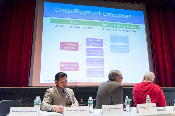 03/25/19 Wesley Bunnell | Staff CT Republicans held a conference on Monday evening at Bristol Central High School to discuss the highway toll proposals as well as alternative options. Newly elected State Senator Genarro Bazzaro , L, looks over his paperwork as State Rep. William Petit and State Rep. Whit Betts look at the slide show being presented.