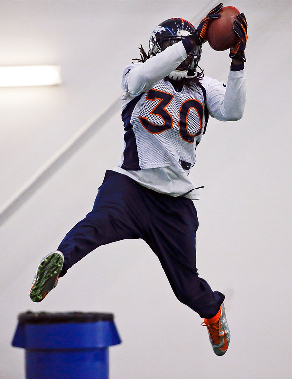 . Denver Broncos safety David Bruton catches a pass during practice Thursday, Jan. 30, 2014, in Florham Park, N.J. The Broncos are scheduled to play the Seattle Seahawks in the NFL Super Bowl XLVIII football game Sunday, Feb. 2, in East Rutherford, N.J. (AP Photo)
