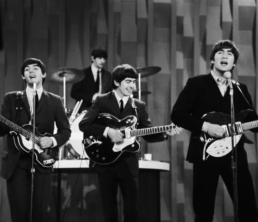 ". FILE - In this Feb. 9, 1964, file photo, The Beatles, from left, Paul McCartney, Ringo Starr on drums, George Harrison and John Lennon, perform for the CBS ""Ed Sullivan Show"" in New York, as they record a set that would later be shown on the Feb. 23 broadcast of the show. The Beatles made their first broadcast appearance on ""The Ed Sullivan Show,"" America\'s must-see weekly variety show, later in the day, Sunday, Feb. 9, 1964, officially kicking off Beatlemania.  (AP Photo/Dan Grossi/ file)"