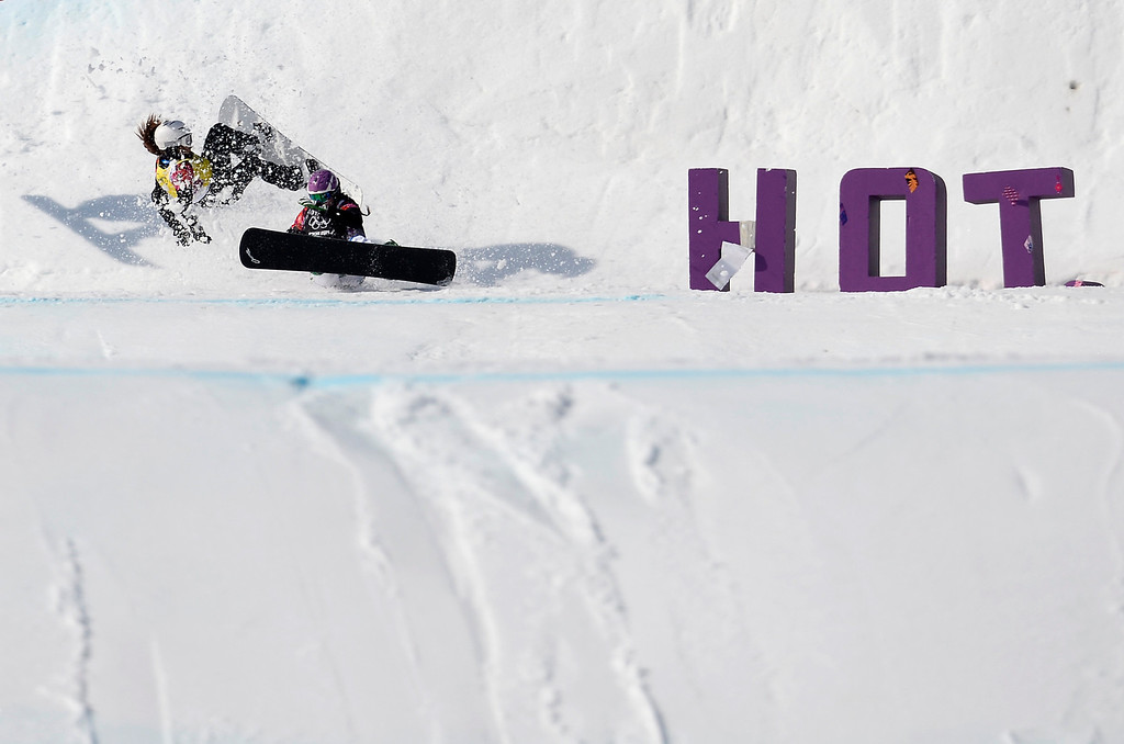 . Italy\'s Michela Moioli (front) and Bulgaria\'s Alexandra Jekova crash in the Women\'s Snowboard Cross Small Final at the Rosa Khutor Extreme Park during the Sochi Winter Olympics on February 16, 2014.    FRANCK FIFE/AFP/Getty Images