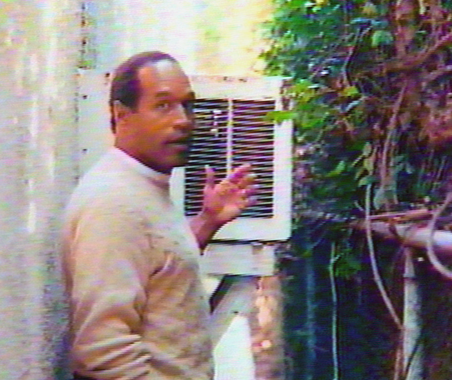 """. O.J. Simpson is seen in the area behind the guest house where Kato Kaelin lived and near the area where former Los Angeles Police Detective Mark Fuhrman reported finding a bloody glove on Simpson\'s Brentwood estate after the murders of Nicole Brown Simpson and Ron Goldman. Simpson taped his own home video after his acquittal to resurrect his image and provide his views on the events in the case. \""""Hard Copy\""""  will broadcast the tape during several episodes starting Wednesday, Jan. 10, 1996. (AP Photo/Hard Copy)"""