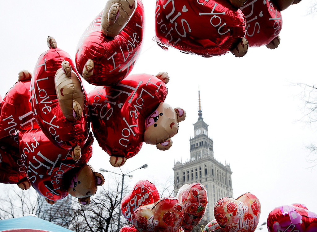 . Heart-shaped balloons as Valentine\'s Day offerings arer pictured against the background of the Palace of Culture in Warsaw, Poland, on Friday, Feb. 14, 2014. Valentine\'s Day was introduced to Poland after the country shed communism and improved the dayís sales of heart-shaped sweets, cakes and balloons. (AP Photo/Czarek Sokolowski)