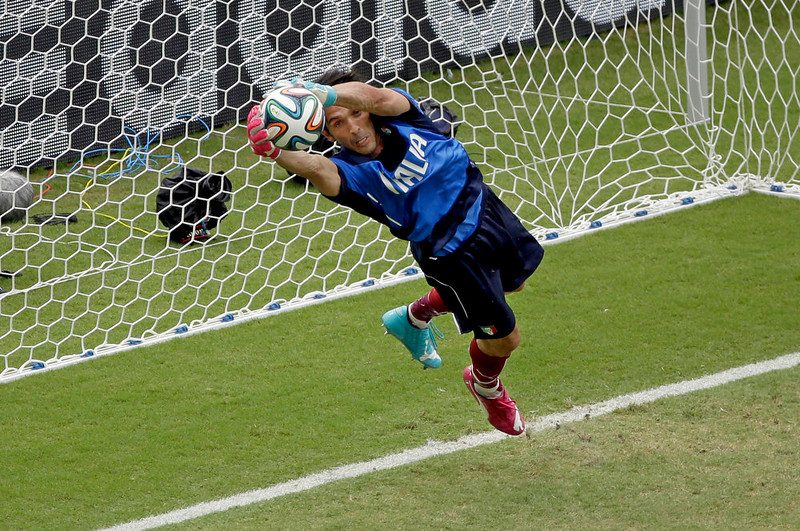 . Italy\'s goalkeeper Gianluigi Buffon prepares for the group D World Cup soccer match between Italy and Uruguay at the Arena das Dunas in Natal, Brazil, Tuesday, June 24, 2014. (AP Photo/Hassan Ammar)