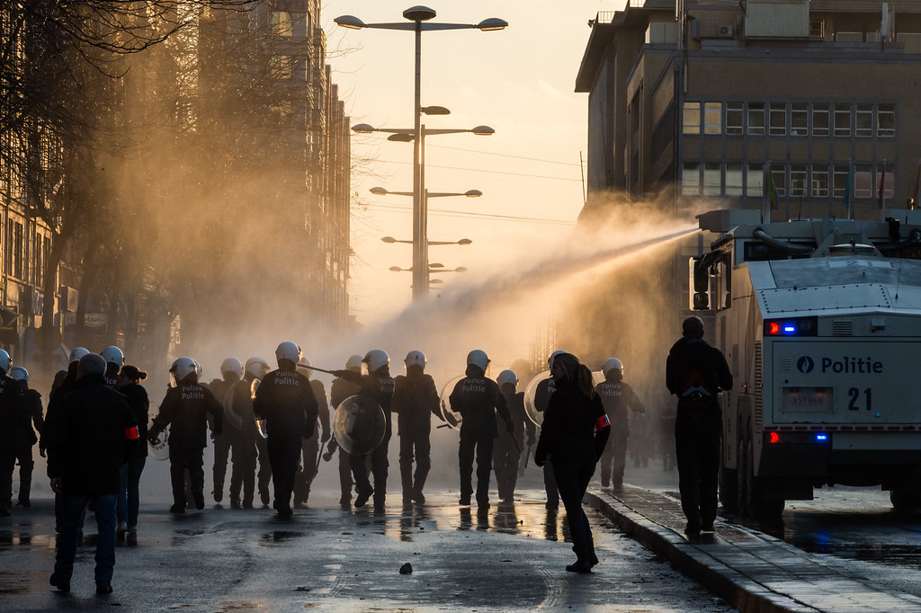 . Police use a water cannon toward protestors during a national trade union demonstration in Brussels, Thursday Nov. 6, 2014.  (AP Photo/Geert Vanden Wijngaert)