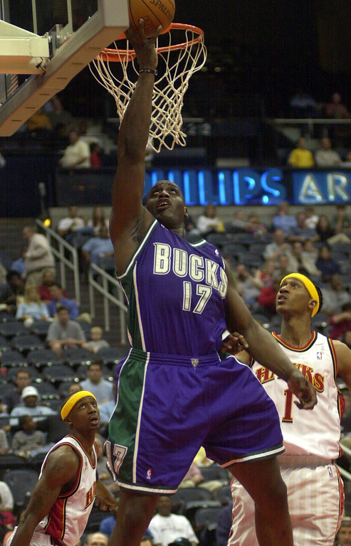 . FILE - Milwaukee Bucks forward Anthony Mason makes a reverse layup as Atlanta Hawks\' Jason Terry (31) and DerMarr Johnson (1) defend during the first quarter in Atlanta Tuesday, April 2, 2002. (AP Photo/Alan Mothner)
