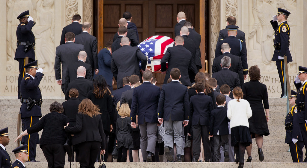 . Family members follow behind the casket of the late Supreme Court Associate Justice Antonin Scalia as they arrive for a funeral mass at the Basilica of the National Shrine of the Immaculate Conception in Washington, Saturday, Feb. 20, 2016. (AP Photo/Pablo Martinez Monsivais)