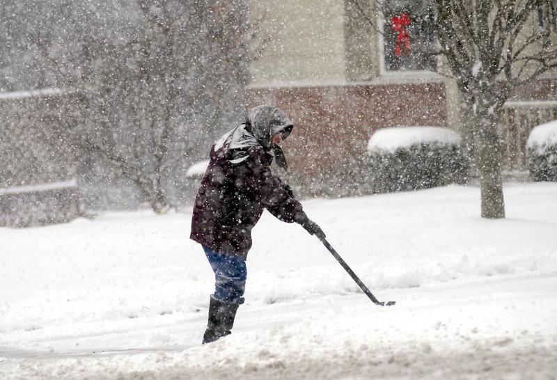 . Connie Armstrong shovels her driveway in Ashland, Ohio, on  Wednesday, Dec. 26, 2012. (AP Photo/Ashland Times-Gazette, Tom E. Puskar)