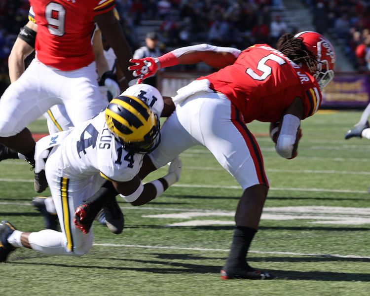 Michigan SS Josh Metellus tackles Maryland RB Anthony McFarland.