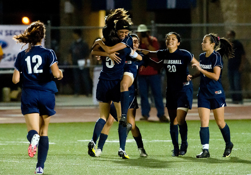 . Marshall\'s Cassandra Bermudez (15) celebrates with teammates after scoring a goal in the second half of the CIF soccer championship game, Arroyo vs. Marshall at Warren High School in Downey on Friday night, March 1, 2013. Marshall won 2-0. (SGVN/Staff photo by Watchara Phomicinda)
