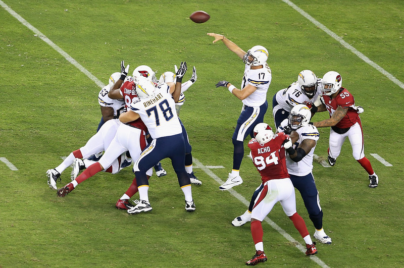. Quarterback Philip Rivers #17 of the San Diego Chargers throws a pass during the first quarter during the NFL game against the Arizona Cardinals at the University of Phoenix Stadium on September 8, 2014 in Glendale, Arizona.  (Photo by Christian Petersen/Getty Images)