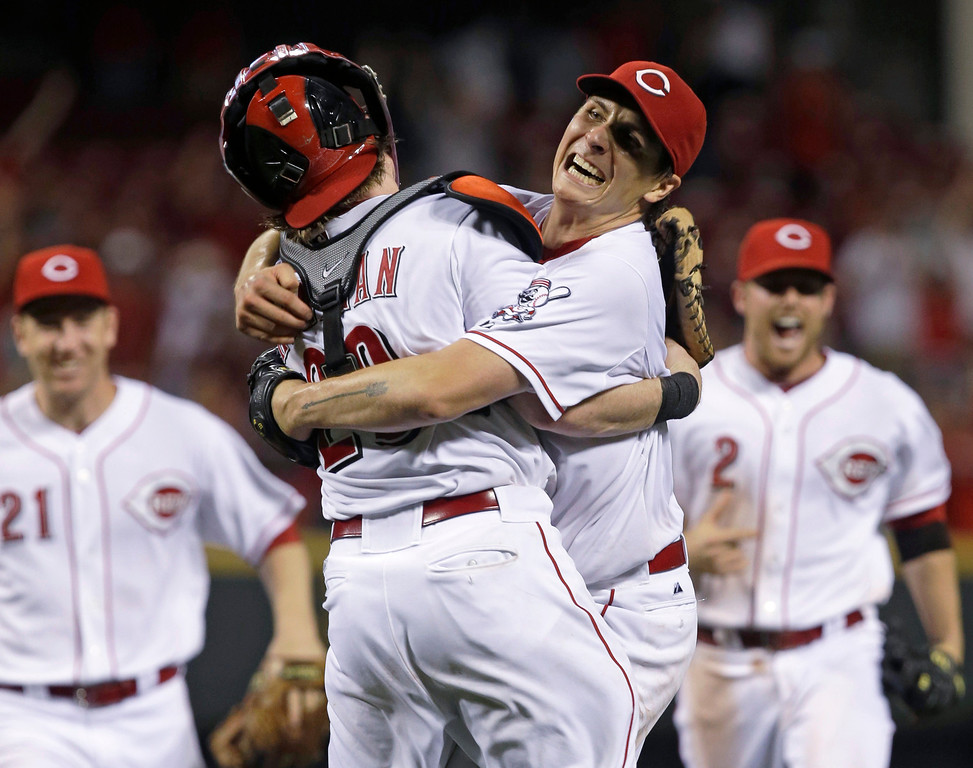 . Cincinnati Reds starting pitcher Homer Bailey, right, hugs catcher Ryan Hanigan, left, after Bailey threw a no-hitter against the San Francisco Giants in a baseball game, Tuesday, July 2, 2013, in Cincinnati. Cincinnati won 3-0. (AP Photo/Al Behrman)