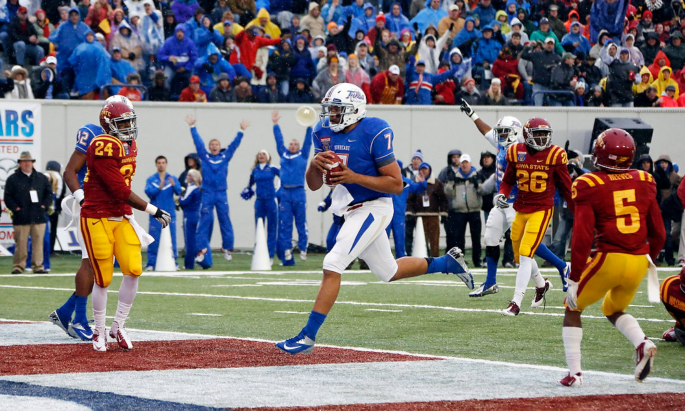 . Tulsa quarterback Cody Green (7) sprints into the end zone with a 7-yard second-quarter touchdown run in the Liberty Bowl NCAA college football game in Memphis, Tenn., Monday, Dec. 31, 2012. (AP Photo/Rogelio V. Solis)