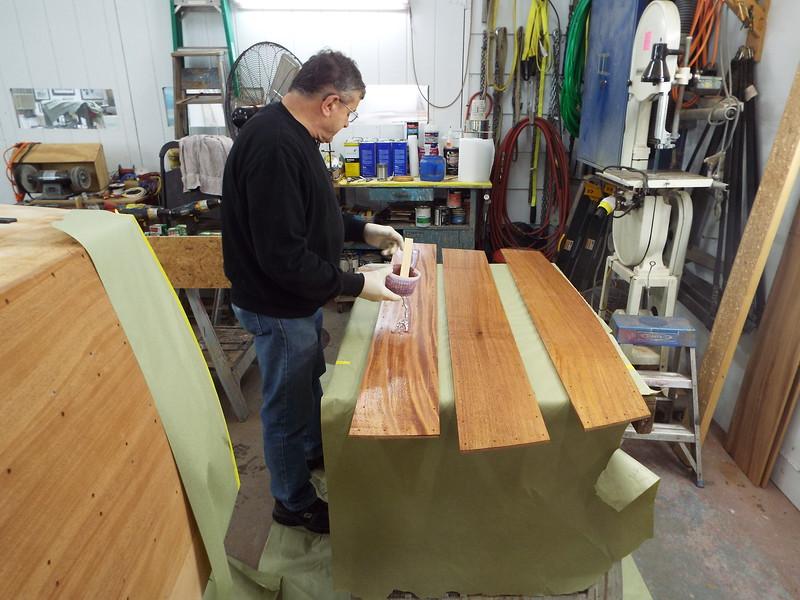 Applying epoxy to the transom planks.