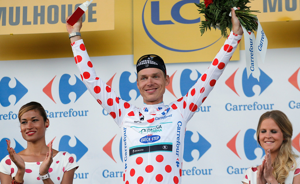 . Stage winner Germany\'s Tony Martin, wearing the best climber\'s dotted jersey, celebrates on the podium of the ninth stage of the Tour de France cycling race over 170 kilometers (105.6 miles) with start in Gerardmer and finish in Mulhouse, France, Sunday, July 13, 2014. (AP Photo/Christophe Ena)