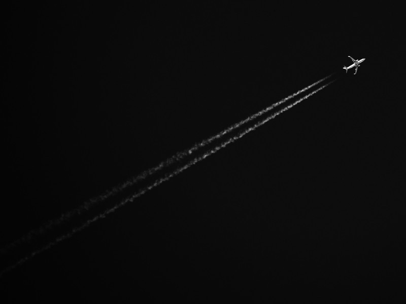 Contrails behind a two-engined airplane, very high up.