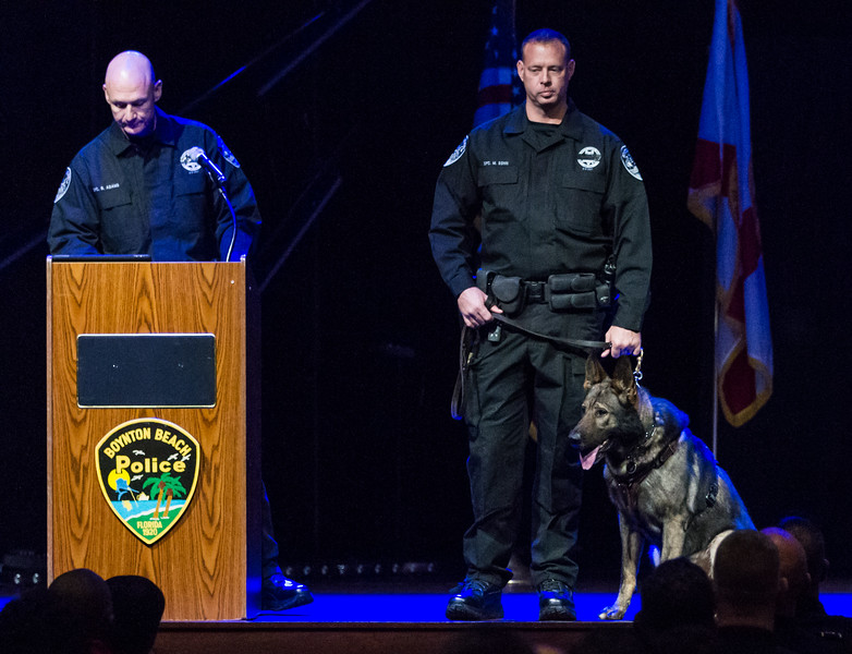 Boynton Beach Police K9 Officer Brian Adams speaks at Boynton Beach Police K9 Officer Joseph Crowder's memorial at Christ Fellowship Church in Boynton Beach on Thursday, January 5, 2016, while K9 Officer Mark Sohn and Crowder's K9 partner Daxxx stand by. Crowder  died suddenly while jogging in December 2016. (Joseph Forzano / The Palm Beach Post)