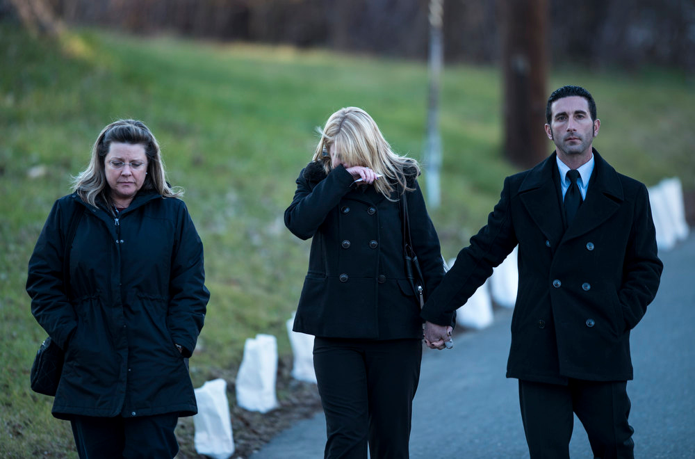 Description of . Mourners leave Woodbury Funeral Home during visiting hours for Dawn Hochsprung on December 19, 2012 in Woodbury, Connecticut. Dawn Lafferty Hochsprung, the principle of Sandy Hook Elementary School, was one of 6 adults in addition to 20 children who were killed in last Friday's shooting at Sandy Hook.  AFP PHOTO/Brendan  SMIALOWSKI/AFP/Getty Images