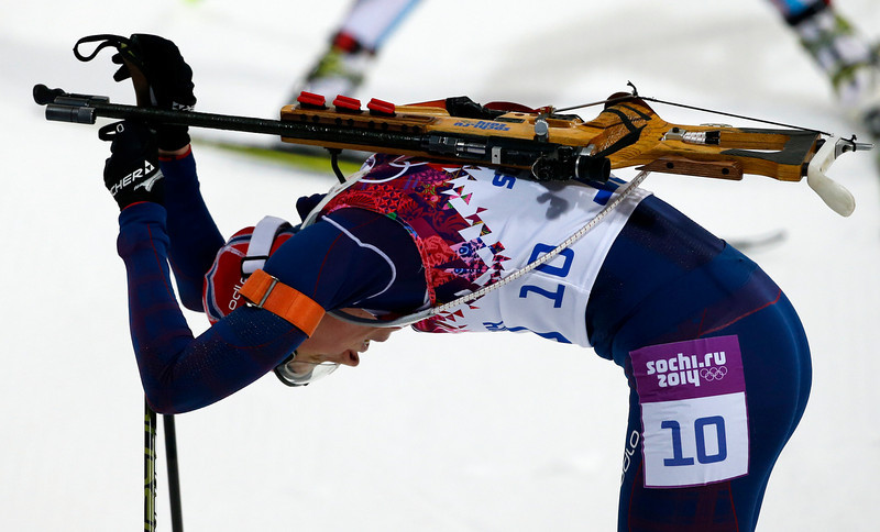 . Norway\'s Tora Berger takes some rest after winning the silver medal in the women\'s biathlon 10k pursuit, at the 2014 Winter Olympics, Tuesday, Feb. 11, 2014, in Krasnaya Polyana, Russia. (AP Photo/Felipe Dana)