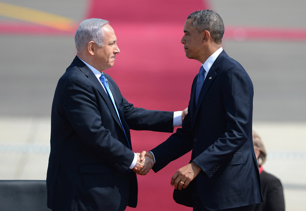 . In this handout image supplied by the Government Press Office of Israel (GPO), US President Barack Obama is welcomed by Israeli President Benjamin Nethanyahu at Ben Gurion International Airport on March 20, 2013 near Tel Aviv, Israel.  This will be Obama\'s first visit as President to the region, and his itinerary will include meetings with the Palestinian and Israeli leaders as well as a visit to the Church of the Nativity in Bethlehem. (Photo by Kobi Gideon /GPO via Getty Iimages)