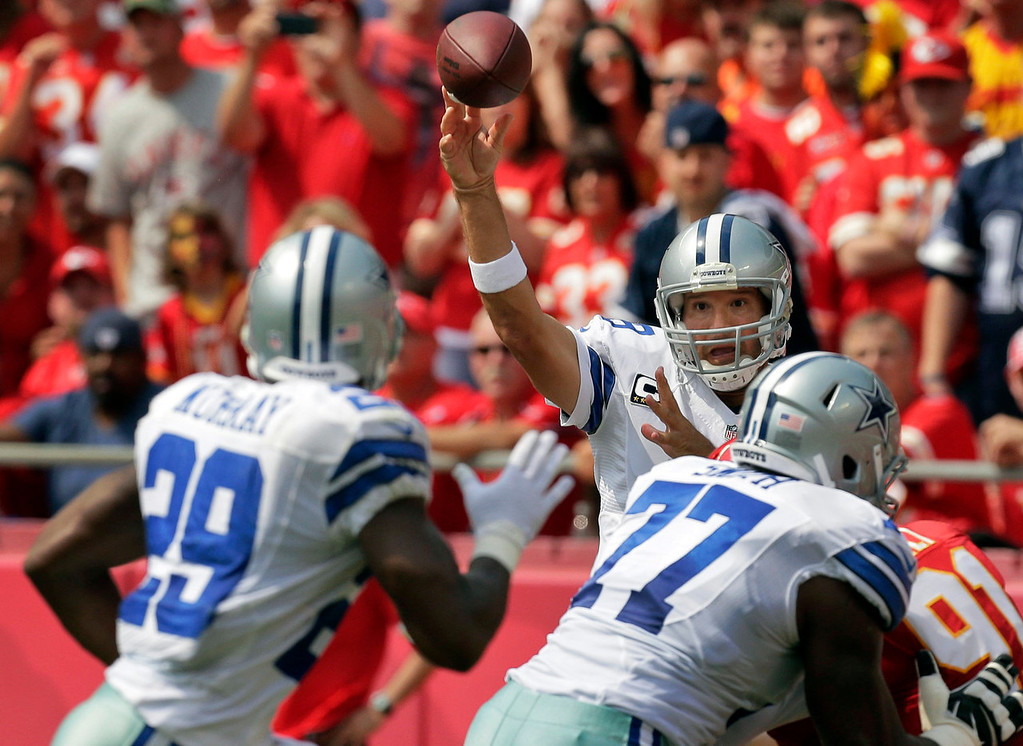 . Dallas Cowboys quarterback Tony Romo (9) passes to running back DeMarco Murray (29) during the first half of an NFL football game against the Kansas City Chiefs at Arrowhead Stadium in Kansas City, Mo., Sunday, Sept. 15, 2013. (AP Photo/Charlie Riedel)