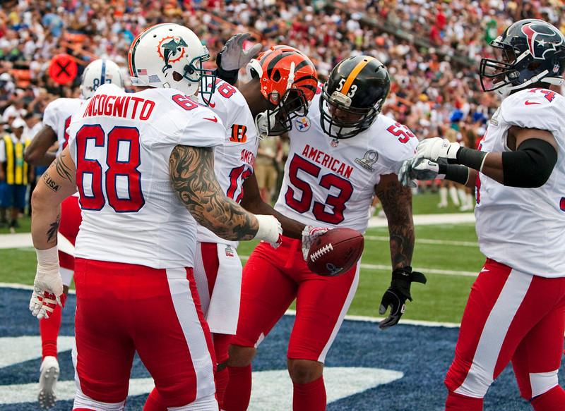 . Miami Dolphins guard Richie Incognito (68), Pittsburgh Steelers center Maukice Pouncey (53), and Houston Texans guard Wade Smith (74), all of the AFC, congratulate teammate Cincinnati Bengals wide receiver A.J. Green (18) on his touchdown against the NFC during the first quarter of the NFL football Pro Bowl game in Honolulu, Sunday, Jan. 27, 2013. (AP Photo/Marco Garcia)
