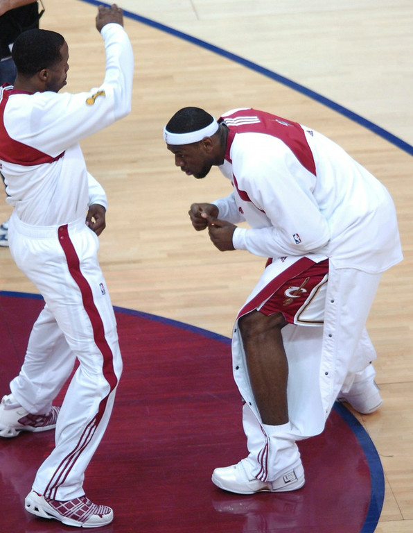 . MORNING JOURNAL/DAVID RICHARD LeBron James goes through one of his pre-game rituals with Damon Jones before last night\'s game.
